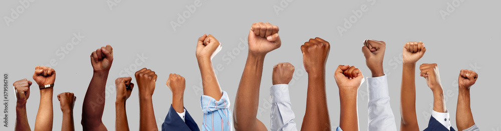Fototapeta civil rights, equality and power concept - african american male hands showing fists over grey background