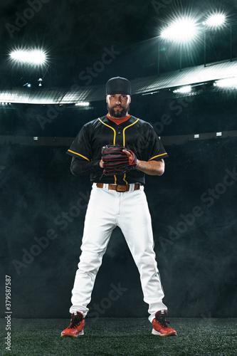 Fototapeta Porfessional baseball player on grand arena. Ballplayer on stadium in action. obraz