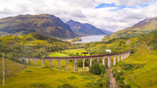 View over the Glenfinnan Viaduct and Loch Shiel - The famous Steam Train Railway in Scotland