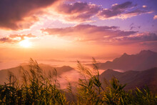 Beautiful Landscape Nature Of Sunrise On Peak Mountain With Sun Cloud Fog And Bright Colors Of Sky In Winter At Phu Chi Fa Forest Park Is A Famous Tourist Attraction Of Chiang Rai Province, Thailand