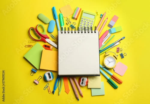 Fotografering Blank notebook and school stationery on yellow background, flat lay with space for text