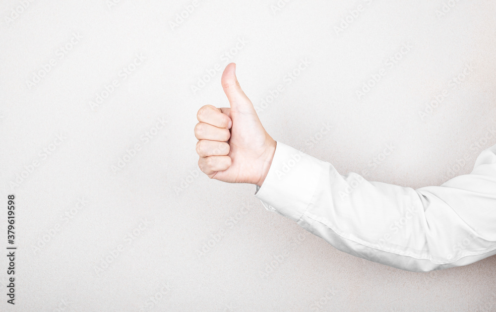 Fototapeta businessman in white shirt shows with hand the symbol of super, insignia. business concept