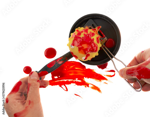Fotomural Child cooks a bleeding toy fish in a pan