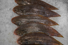 Largescale Tongue Sole Fish (Cynoglossus Arel) From The Ocean On Ice In Thailand Market. Frozen Tongue Sole Fish On Cool Ice. Seafood Background, Seafood Market.