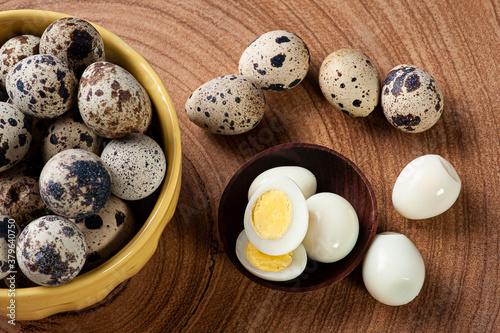 Fotografie, Obraz .Boiled quail eggs arranged on wooden background