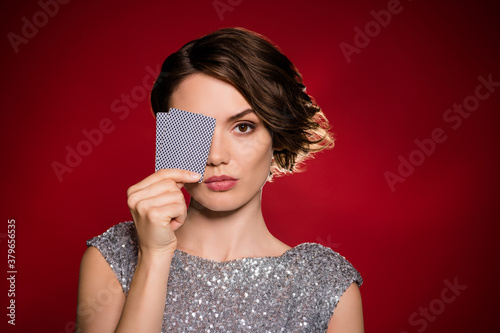 Closeup photo of attractive lady professional casino player hiding eye hold two Canvas Print