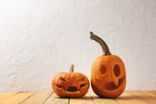 Two Pumpkins On Wooden Table. Halloween And Autumn Food Background