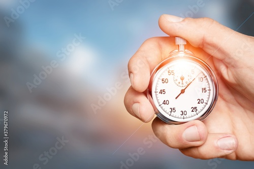 Photo Silver classic stopwatch in human hand