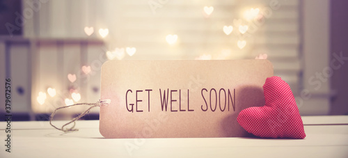Foto Get well soon message with a red heart with heart shaped lights