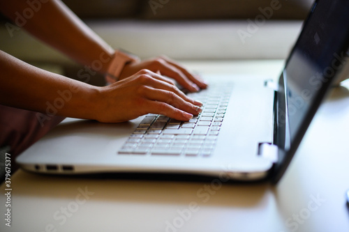 Closeup of a woman typing on a laptop keyboard Canvas