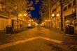 Walking Illuminated night Grado town. Deserted streets of touristic italian city in winter at night.