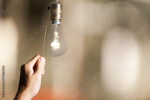 canvas print motiv - BillionPhotos.com : Hand turning off the bulb lamp.Turning off the light.