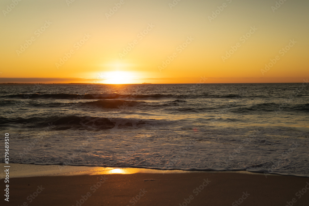 Waves and sunset at the beach