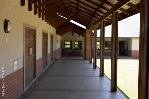 Fotografie, Obraz Exterior corridor of an elementary school