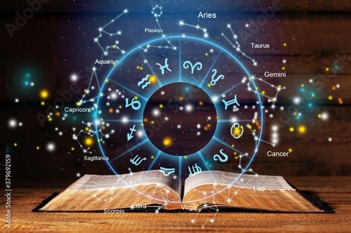 Obraz Horoscope astrology zodiac illustration with old book - fototapety do salonu