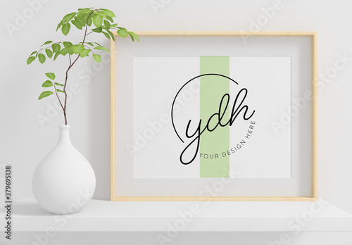 Horizontal Frame on a Shelf with Plant Mockup