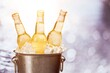 Bottles of cold and fresh beer with ice in the bucket