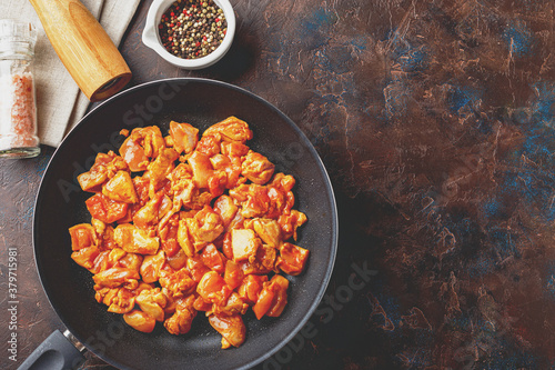 Valokuva Chicken fillet cut into small pieces for frying in pan