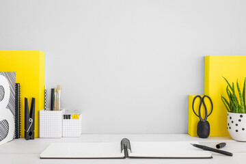 Grey workspace and yellow supplies.