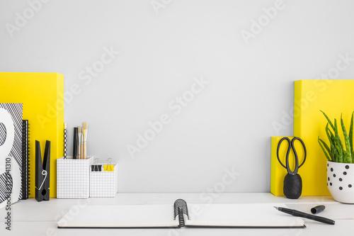 Fototapeta Grey workspace and yellow supplies. obraz