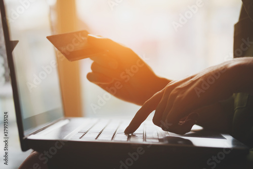 Fototapety, obrazy: young woman using laptop and holding credit card, online shopping concept