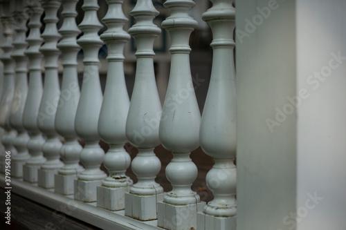 Papel de parede Balusters in the decoration of the veranda railings.