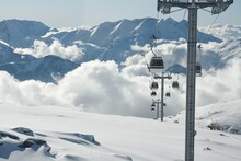 Ski Lift Cabins In Snowy Mountains In Alpe D'Huez