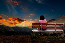 Person Sitting On A Bench