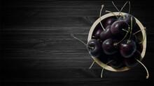 Cherry On Black Wooden Backgro...
