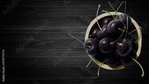 Valokuvatapetti Cherry on Black wooden background