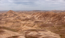 Panoramic Desert Landscape In The Remote Part Of The Judean Desert, Israel. Natural Terraces With Escarpments, Dry Wadies, Orange Sandy Hills And Desert Formations.