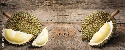 Fotografie, Obraz Durian riped and fresh, Durian peel with yellow color on old wood background