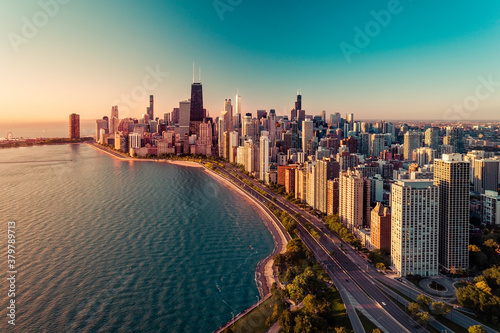 Obraz Chicago skyline aerial view with light effect applied. Sunrise above downtown buildings and Lake Michigan - fototapety do salonu