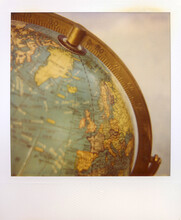 Polaroid Photograph Of A Vintage Globe