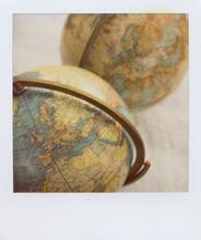 Polaroid Photograph Of A Vintage Globes