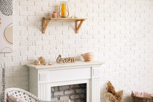 Fototapeta Modern fireplace near wall in room obraz