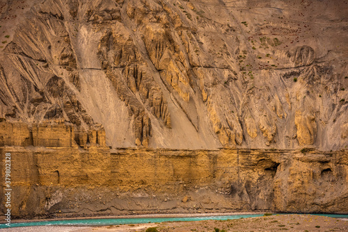 Fototapeta Gully erosion landscape prominent in cold desert of Spiti due to barren steep slopes & weak unconsolidated geological mud rocks. River erosion also visible on downward slopes of hills. obraz na płótnie