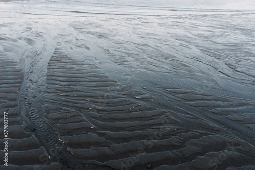 Carta da parati the low tide in the North sea in winter on a frosty day exposed the bottom with
