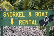 Beach Sign Saying Snorkel & Boat Rental