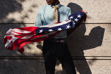 Afro Businessman With American Flag On Copyspace Wall