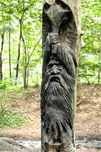 Statue Of Wooden Dwarf With Big Bludgeon Above Head