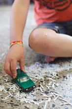 Close Up Of Boy Playing With Toy Car