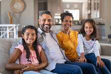Happy Multiethnic Family Sitti...