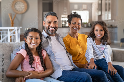 Happy multiethnic family sitting together - 379835765