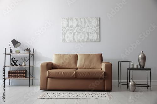 Fototapeta Modern living room interior with stylish leather sofa