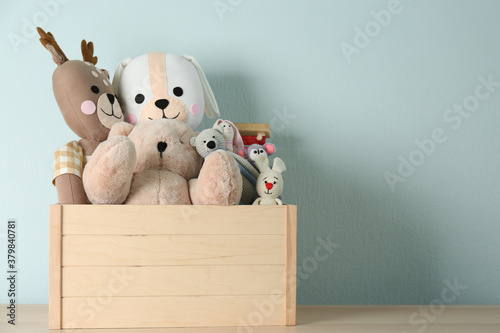 Fototapeta Crate with different toys on wooden table. Space for text obraz