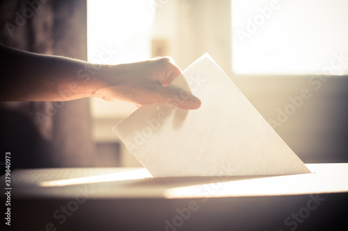Fototapeta Conceptual image of a person voting during elections obraz