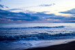 canvas print picture Water of sea and sky with clouds and sunset.