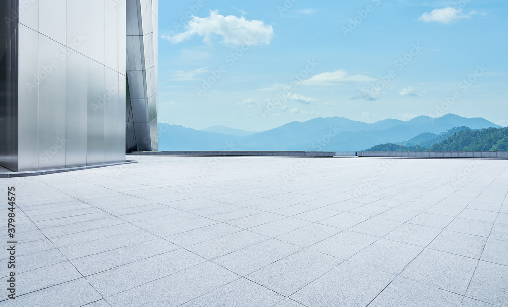 Fototapeta Empty concrete tiles floor with modern architecture and beautiful landscape