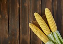 Fresh Corn Cobs On Wooden Surf...